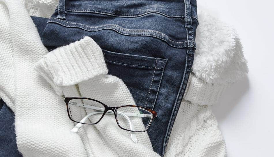 THe picture shows clothes and glasses to prevent the wearer from using their clothes to clean up their Progressive glasses with it.
