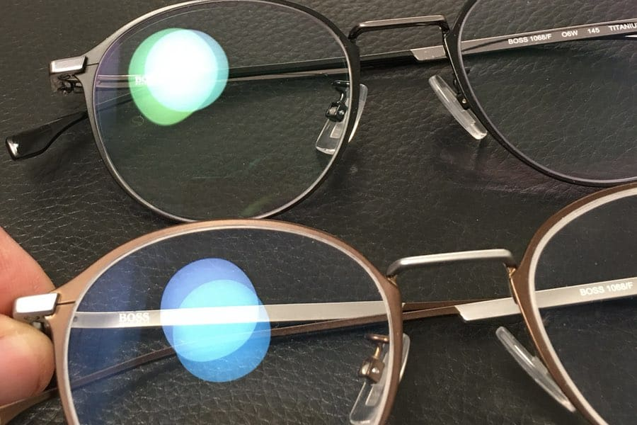 The picture shows progressive lenses with different anti reflective coatings