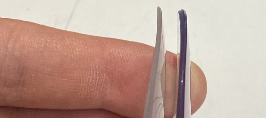 the picture shows two different lenses for glasses. on the left the lenses were produced in the thinnest possible way